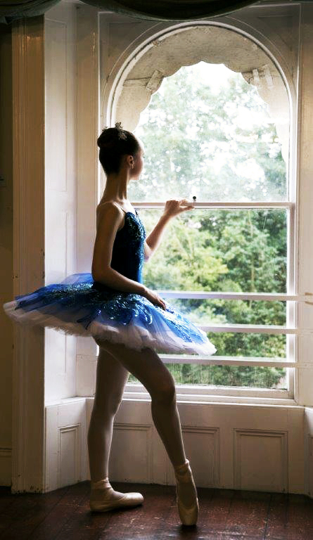 ballerina at a window